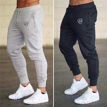 2018 été nouveau mode mince section pantalon hommes décontracté pantalon survêtement Bodybuilding Fitness sueur temps limité pantalons de survêtement
