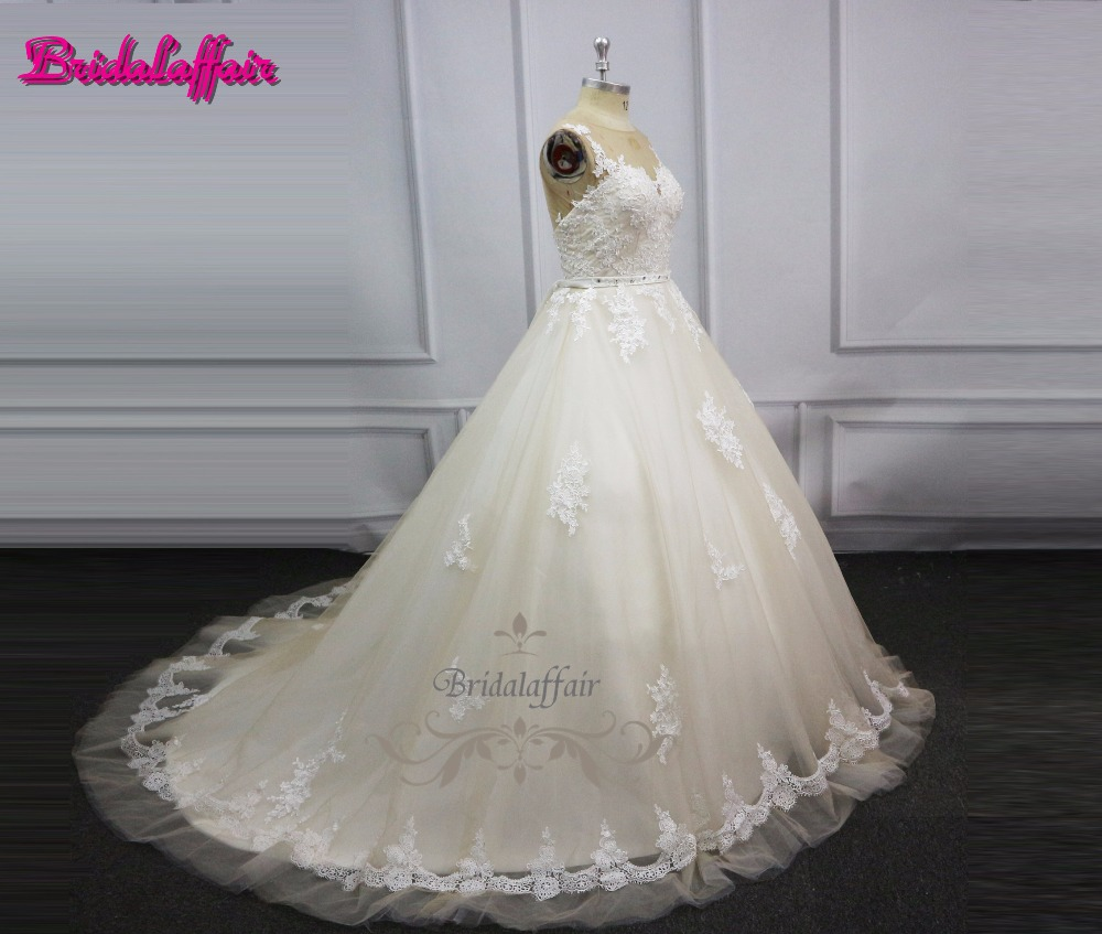 Vestido de Noiva long sleeve Ball Gown Vintage Robe De Mariage special lace design nude tulle wedding dress factory video in Wedding Dresses from Weddings Events