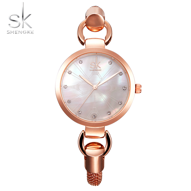 SK New fashion women wristwatches elegant rose gold diamonds girl's clock hollow out Stainless Steel strap Quartz watch 2017