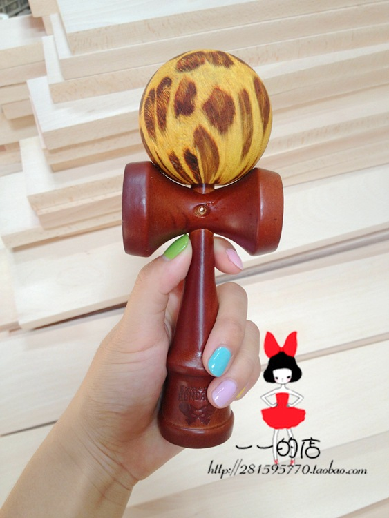 Professional racing tips ball ball wooden toys sword leopard head the ball over three of ...