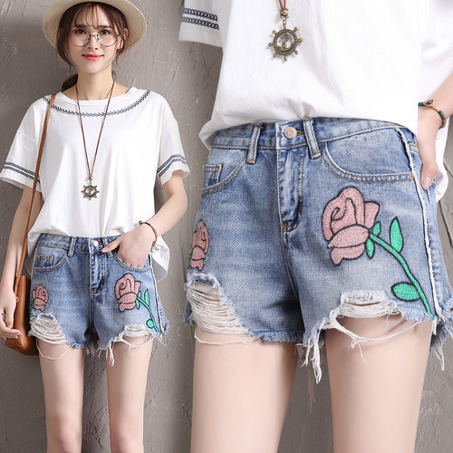 The new summer student shorts female retro embroidered flowers hole hair fringed denim shorts all-match  fashion