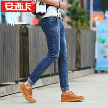 Men's fashion pocket hole ripped jeans Casual patchwork slim straight  blue denim pants Long trousers