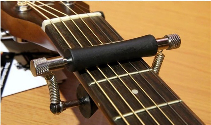 qhx new arrival slide guitar capo guitar accessories parts for acoustic electric guitar bass. Black Bedroom Furniture Sets. Home Design Ideas