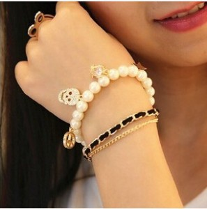 Korean version of the multi-layered delicate skull bracelet ladies fashion imitation pearl jewelry crown of stars free shipping