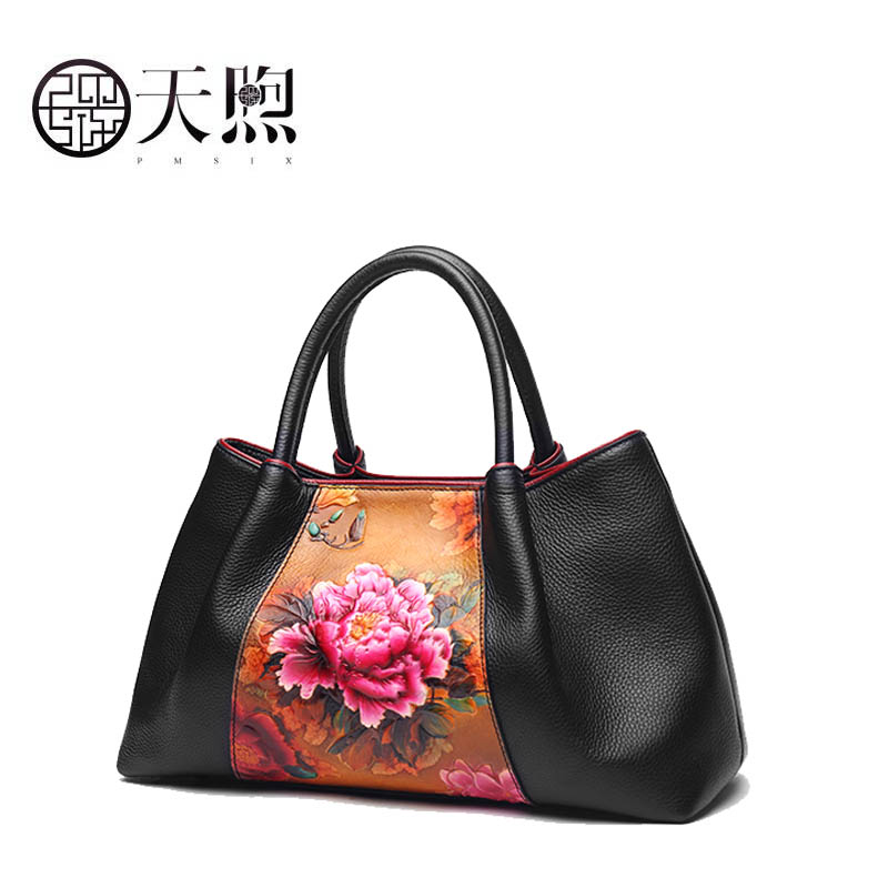 Pmsix 2018 new large-capacity national wind embossed flower layer leather portable handbag Designer bagPmsix 2018 new large-capacity national wind embossed flower layer leather portable handbag Designer bag