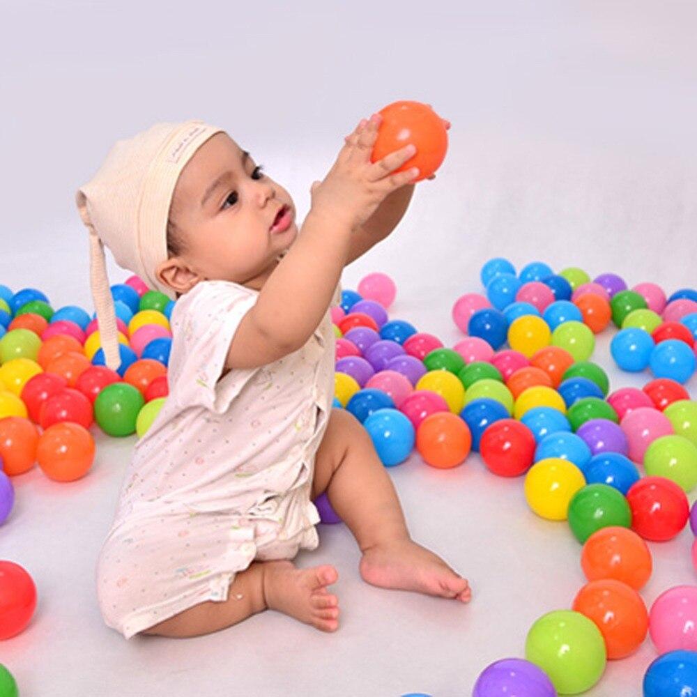 100 unids/lote ecológico colorido plástico blando Water Pool Bola de olas del océano estrés Bola de aire niños juguetes para niños
