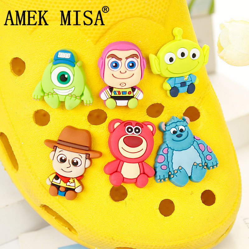 Novelty Cute 12 Pcs 2 Sets PVC Garden Shoe Charm Decorations Toy Story and MU Accessories Shoe Buckle Fit Bands Bracelets Croc in Shoe Decorations from Shoes