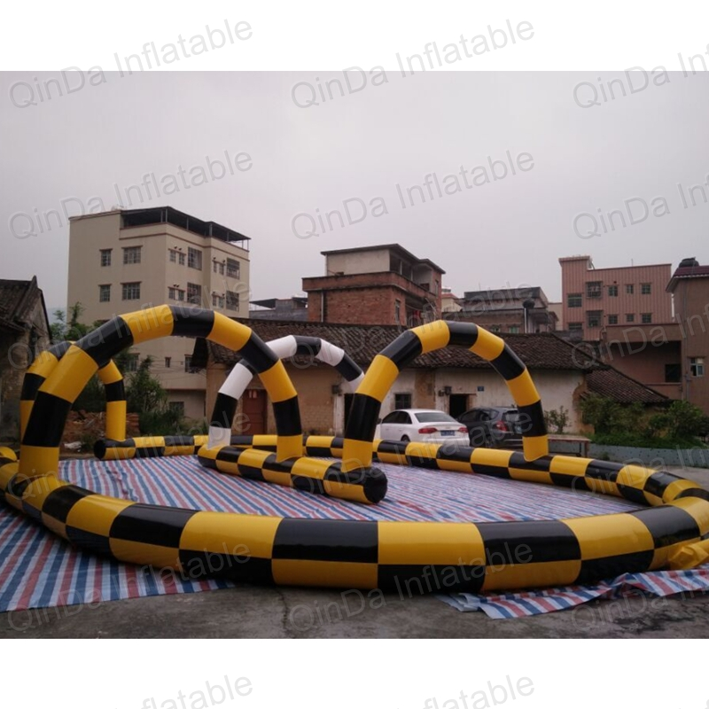 Guangzhou Qinda New design Rental inflatable speedway race track , go kart inflatable barrier Running Way kids play outdoor sports games go kart race air track for balls inflatable race track