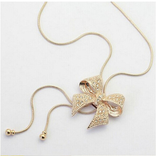 KUNIU 2017 Gold Long Chain Bowknot Rhinestone Necklace Sweater Chain for Women Girl Lady