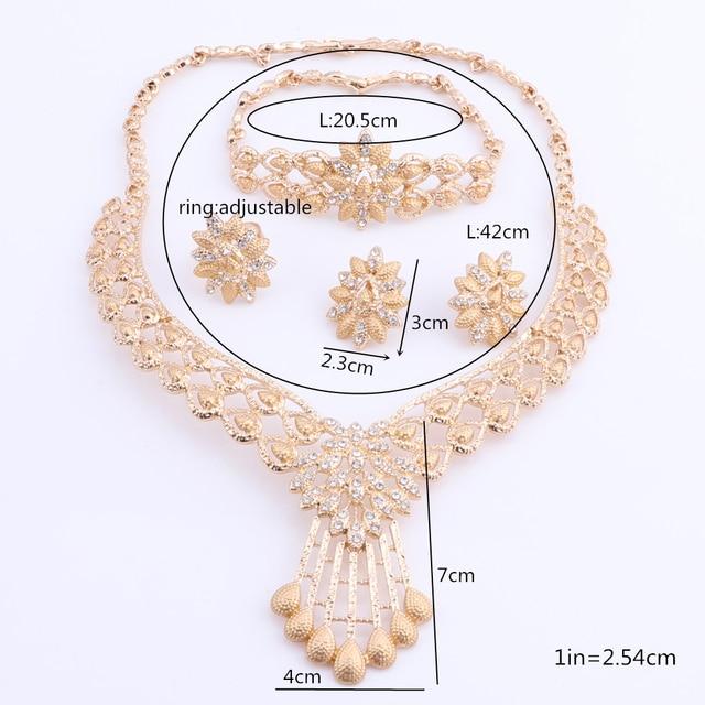 Купить женский свадебный ювелирный комплект из колье серёг и кольца