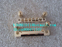 free shipping new  strings electric guitar bridge in gold made in China 8205-2