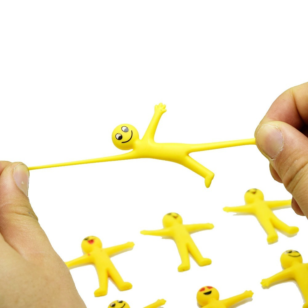 5 Pieces/lot TPR Soft Plastic Creative Expression Small Yellow Man Can Pull The Little Doll Capsule Toys