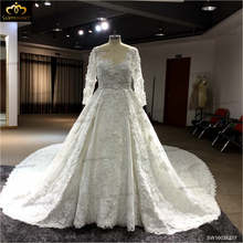 Royal Train lace Wedding Dresses 2016 Romantic Appliques Lace Bride Dresses with heavy beading Long Sleeves
