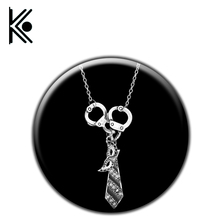 Free Shipping Fifty Shades of Grey Darker Freed Christian Charm Necklace Handcuffs Masquerade Mask Necktie Pendant Necklace(China)