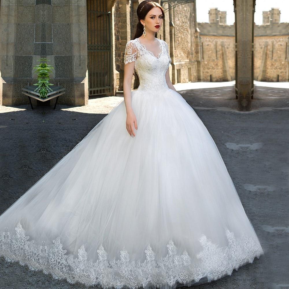 Vestido de novia con manga corta de encaje