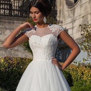 Image 2 - Vestidos de novia Ballkleid Weiß Schatz Appliques Cap Sleeve Braut Kleider 2019 Billige Kunden Spitze Backless Hochzeit Kleider