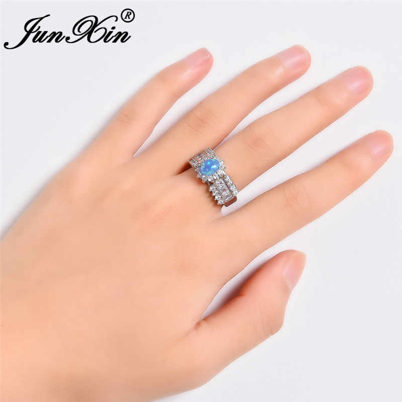 JUNXIN 90 OFF! Vintage White/Blue Fire Opal แหวนผู้หญิงสีขาวรูปไข่ Rainbow หิน Zircon งานแต่งงานแหวนเครื่องประดับ Boho