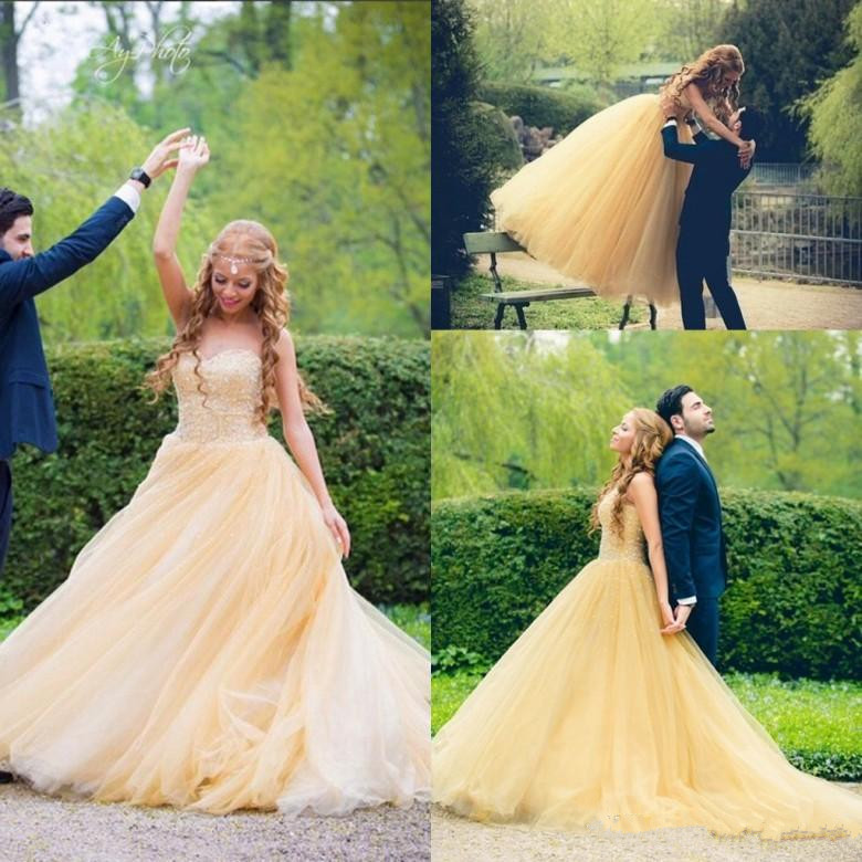 Romantic Yellow Tulle Wedding Dresses 2019 New Ball Gowns Sweetheart Appliques Beaded Puffy Skirt Long Bridal Gowns Arabic Party
