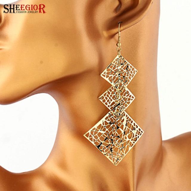 8bdd6cb2377b Pendientes largos de hoja Hollow Boho SHEEGIOR para mujer accesorios  adorables aretes colgantes cuadrados de aleación
