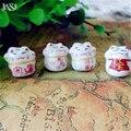 JINSE 100 unids Lindo lucky porcelana cerámica colorido gato de la Fortuna animal beads 15mm DIY Maneki Neko Gato forma del grano moda CSB013
