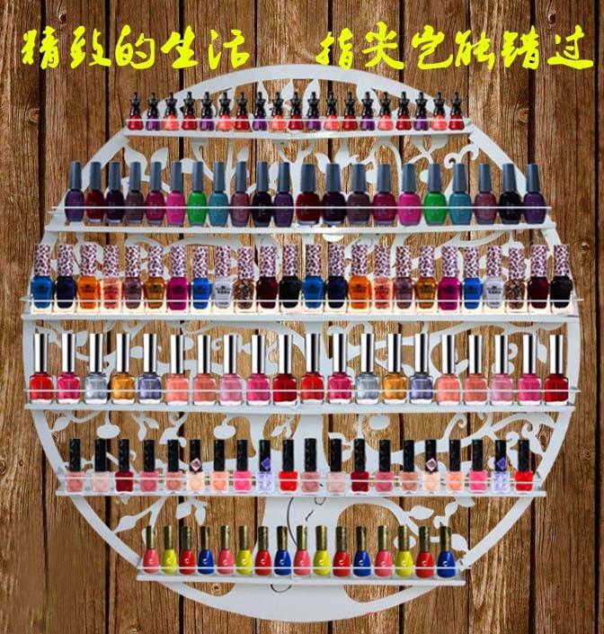 Hang a wall, wrought iron nail polish carrying shelves. Nail salons display shelf
