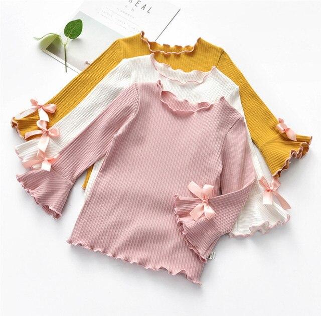 חדש אביב סתיו חורף בנות חולצות ילדים לבן ורוד ארוך שרוול תחרה קשת תינוקת חולצות t חולצה פעוט ילדים בגדי מתנות