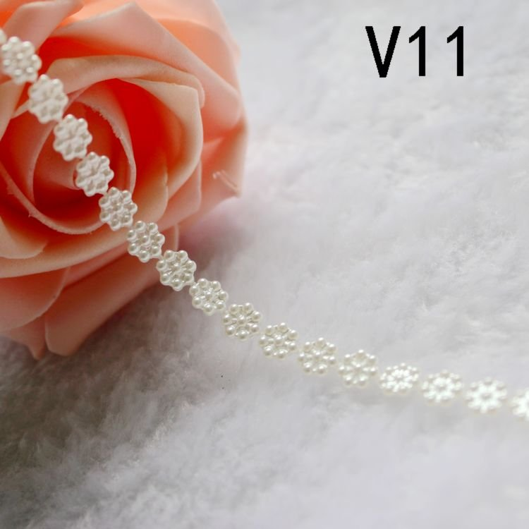 Free shipping  Imitation pearls chain flatback  resin  material beads chain many styles to choose for clothes wedding dresses free shipping imitation pearls chain flatback resin material half pearls chain many styles to choose one roll per lot