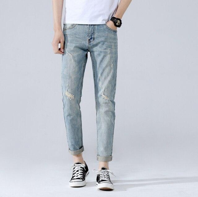 f1f8a203556 Jeans para hombre 2019 nuevos vaqueros ajustados para hombre azul claro  desgastado nueve pantalones clásicos Simple