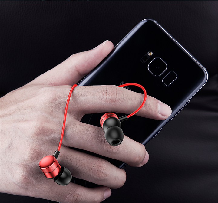 Foto with phone red color In-Ear earphones with microphone. In-Ear earphones with microphone for iphone