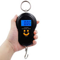 100 piezas LCD Digital 50 kg * 10g sonrisa cara de mano electrónica colgante pesca gancho peso 50000g escala con luz de fondo 20% de descuento