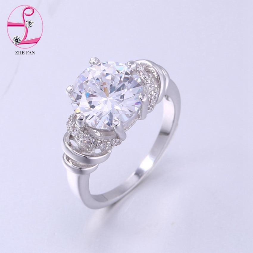 3cee15ecd847 ZHE FAN blanco partido ronda anillos AAA CZ cúbicos Zircon moda Halo anillo  mujeres boda Día de San Valentín regalo de la joyería marca 4 Prong