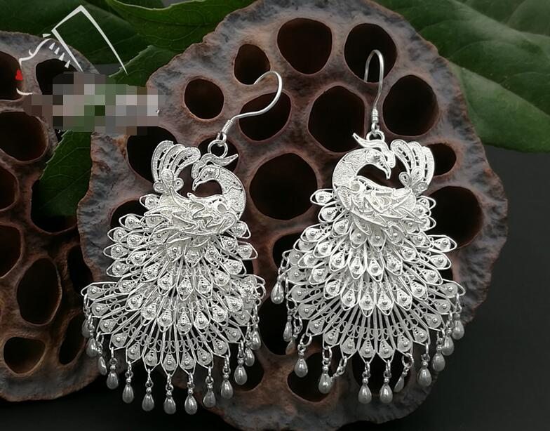 S999 sterling silver original national fan wind pee ear pendant Miao hand brushing allergyS999 sterling silver original national fan wind pee ear pendant Miao hand brushing allergy