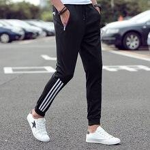 Men's stretch casual pants 2021 spring classic brand clothing elastic waist large size men's fashion jogging pants black blue