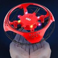 Mini di Volo in Elicottero UFO RC Drone Mano di Rilevamento Aereo Con 6 luci A LED Elettronico Quadcopter flayaball Giocattoli per i bambini