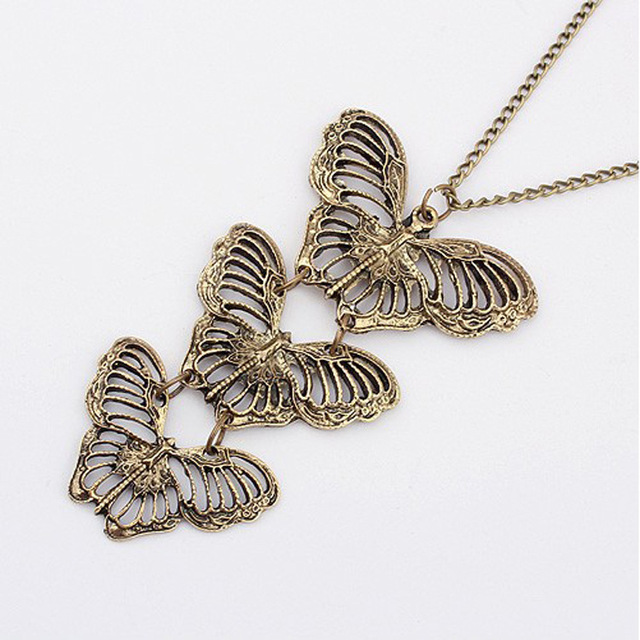 N380 fashion national wind European and American trade vintage hollow butterfly pendant long necklace sweater chain wholesale