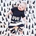 ST231 2016 novo estilo terno dos esportes de verão menino conjunto de roupas de moda tecido macio do bebê meninas meninos esporte terno 2 pcs. definir a roupa dos miúdos