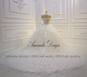 Image 4 - Amanda Design abiti da sposa Off Schulter Kurzarm Spitze Appliqued Pailletten Hochzeit Kleid
