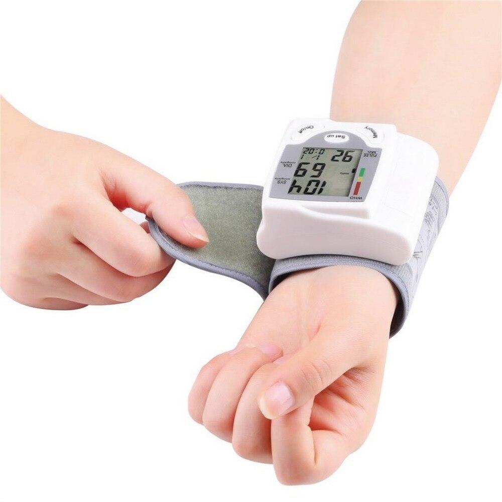 Portátil Digital de pantalla LCD Digital de muñeca Monitor de presión arterial corazón dispositivo pulso medida Metro Tonometer blanco