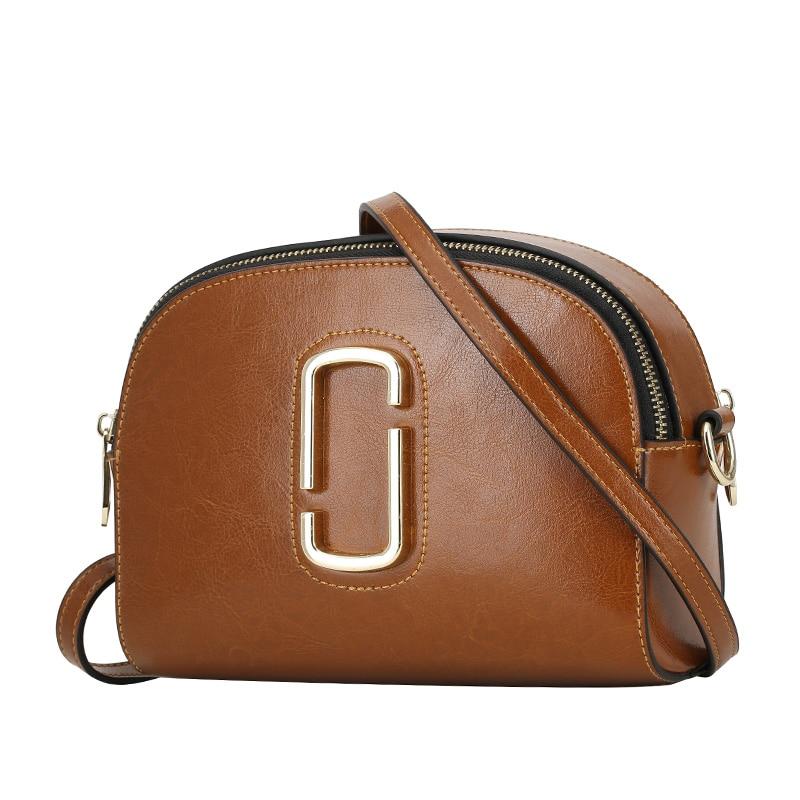 все цены на LUODUN 2018 Casual Avant-garde Fashion Leather Bag Oil Wax Leather handbag Europe and America Ms. Shoulder Messenger Bag