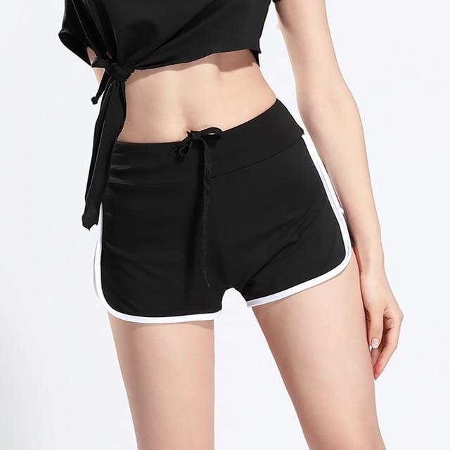 Falso de duas peças Mulheres negras Treino Shorts Fêmeas Calções De Fitness  Exercício Musculação Quick Absorver 8ef3135ccf8d0