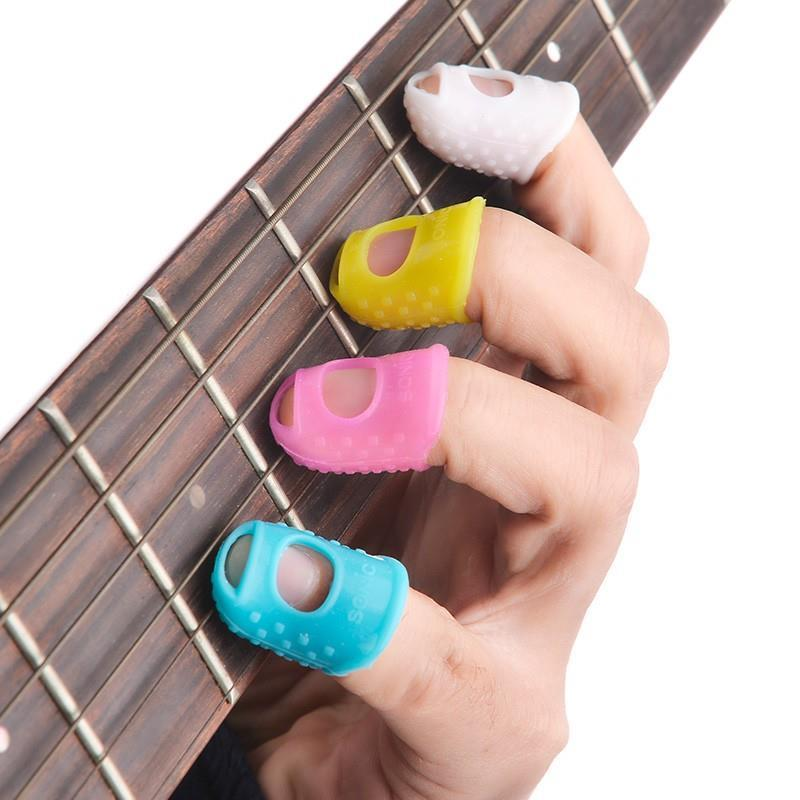 freight free colors guitar fingerstall guitar prevent pain protect fingers soft cots comfortable beginners finger-cot 4 pieces