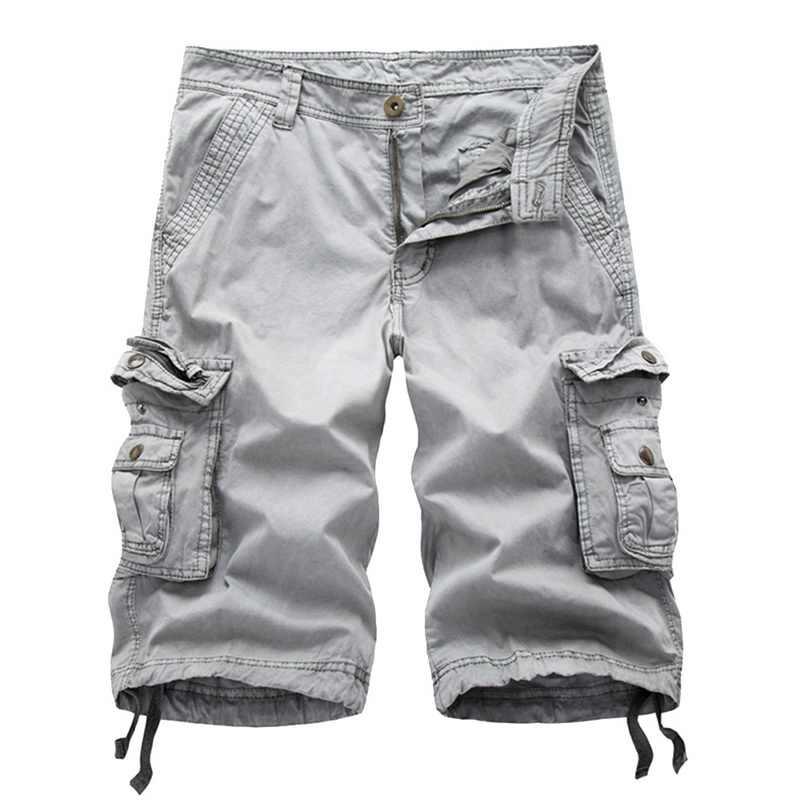 MONERFFI nuevo 2019 Multi-Bolsillo hombres Cargo pantalones cortos Casual suelto corto pantalón sólido camuflaje militar verano rodilla largo Plus tamaño de pantalones cortos