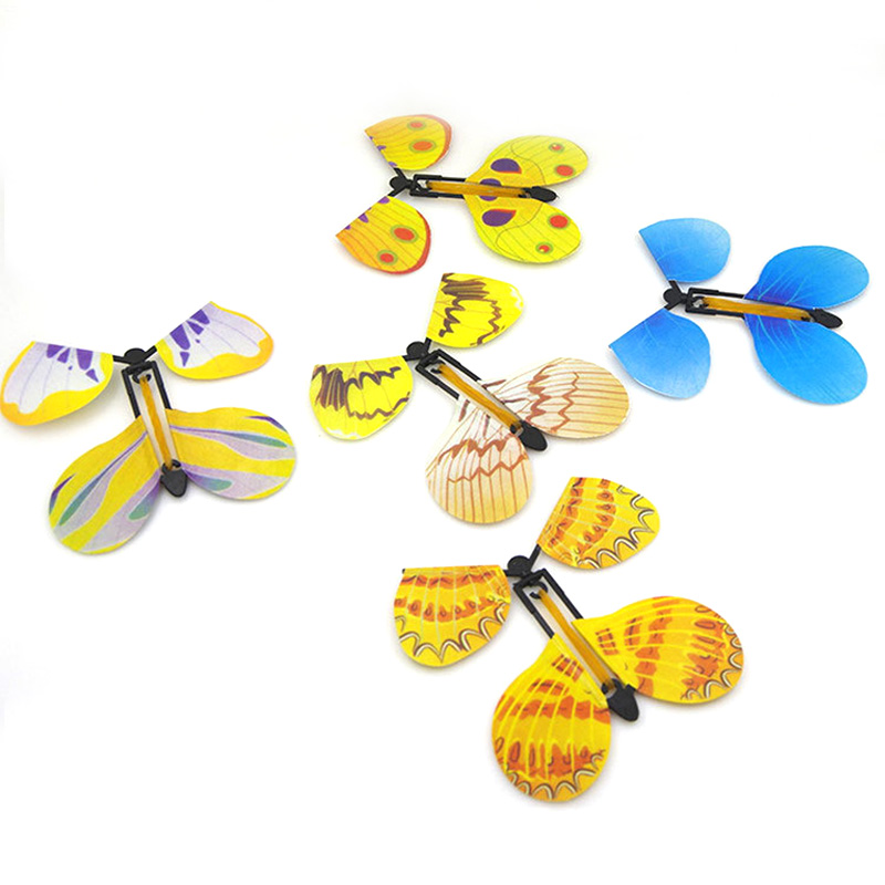 Hot 1 or 5 or 10PCS Random Funny Flying Magic Butterfly Cocoon Transforming Kids Trick Toys Accessories