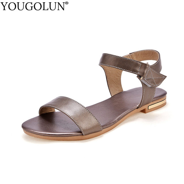 f8a10ecc0909 YOUGOLUN Women Flat Sandals Summer New Woman Genuine Leather Metal Casual Ladies  Gold Black White Cross Strap Shoes  A-115
