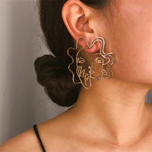 Simple Personality Hollow Human Face Stud Earrings Exaggeration Alloy Geometric Fashion Accessories Wholesale