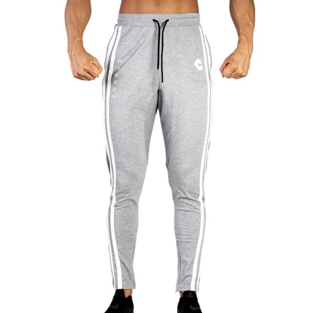2019 hommes décontracté Fitness Joggers pantalons gymnases Stretch coton hommes Skinny pantalons de survêtement Slim entraînement Zipper cheville pantalon hommes
