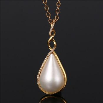 751d911e88e9 Pequeño diamante gota de agua collar de perlas 18 K oro Real giro collar  Natural de mar blanco perla colgante collar de la collar de joyería de las  mujeres