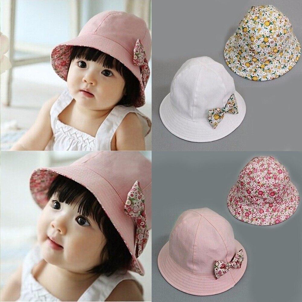 Puseky 2017 verano flor imprimir algodón bebé sombrero niños Niñas floral  bowknot Cap Sol Sombreros de pesca doble cara puede llevar gorro 7cccef0db80d