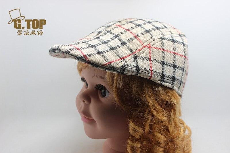 2016 Printemps Automne Mode Bébé Enfant Enfants Chapeau De Béret Gatsby  gavroche Golf Garçons Casquette Plate Plaid Chapeau Garçon Fille Béret  chapeau a050535e1ad