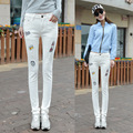 2016 new female Korean stretch jeans slim pencil pants white hole feet badge embroidery